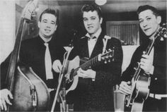Saturday February 5, 1955 Memphis Press-Scimitar   GOOD ROCKIN' -- A white man's voice singing negro rhythms with a rural flavor has changed life overnight for Elvis Presley (center), shown here with Bill Black (left) and Scotty Moore (right). Elvis will sing for the home folks at Ellis Sunday. Press Scimitar Staff Photo