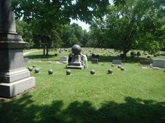 The large monument is the family name, the little balls around it are family members. Marion,Ohio