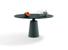 Mesa table combines the two simple geometric shapes of a circle and a cone.  The top is composed of Ligurian slate which, thanks to the traditional splitting technique, retains the rock's natural grooves and lines on the surface. The supporting column is made from grey Pietra Serena sandstone. The overall effect is a physical monolith which is solid and compact yet light at the same time.     Discover more on: http://poltronafrau.com/en/catalogue/icons/mesa