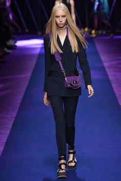 Versace teamed sporty track jackets and nylon dresses with sparkling chainmail embellishments.
