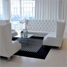elegant tufted banquette in a plush white microsuede with 4 white throw pillows each L-shaped banquette seats 8 people and is…