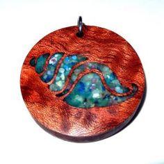 Nautical pendant. Crushed seashell inlay. Figured Bubinga wood. Dharma Wanderlust. Resin Jewlery, Nautical Pendants, Scroll Saw, Sea Shells, Exotic, Wanderlust, Jewellery, My Style, Wood