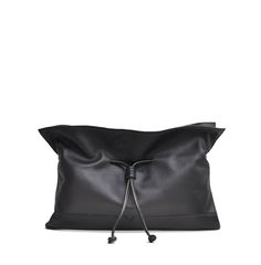 The Oversized Clutch in Black from von Holzhausen featuring natural grained soft Italian leather with painted edges. Interior includes credit card holders and one open pocket.