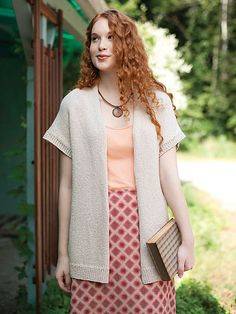 This classic short-sleeved cardigan with a rolled neck edge is sure to become a wardrobe staple. (Berroco.com)
