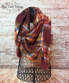"""Blanket scarves are another must have this season! This one is THE perfect plaid. Lightly fringed edges, and oversized to keep you warm and cozy. Measures approximately 60"""" by 60"""". 100% Acrylic."""