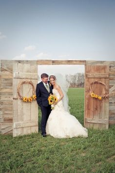 rustic country barn door and suunflowers wedding backdrop