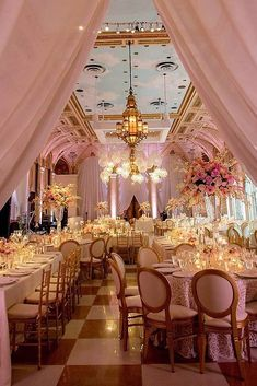 30 Glamorous Rose Gold Wedding Decor Ideas ❤ rose gold wedding décor elegant wedding reception in golden pink tones with high flower vases on the tables and a cloudy sky on the ceiling chris joriann photography ❤ See more: http://www.weddingforward.com/rose-gold-wedding-decor/ #wedding #bride #weddingdecor #weddingdecorations #rosegoldweddingdecor