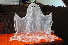 Cheesecloth ghost.  I made one in grade school, they're super easy and adorable.  I think I might make a whole haunting of them for halloween.