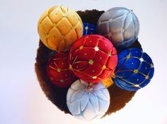 High quality Christmas balls made in the Japanese technique of kimekomi. The basis of the ball is polystyrene. Decoration of various fabrics - these balls are decorated with yellow, red, gray and bright blue velvet, silver and gold cord and sequins. The ball has a metal eyelet.