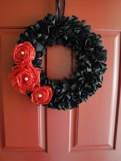 "red and black wreath- with ""roses"" - made before as a KY Derby wreath"