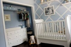 """Another beautiful boy nursery!  Love the diagonal """"tape"""" on the wall and the dresser in the closet.  Could be changing table.  Baby bed against the adjacent wall."""