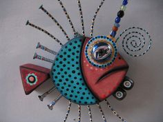 Twisted Guppy 4, Original Found Object Sculpture, Wood Carving, Wall Art, by Fig Jam Studio. $65.00, via Etsy.