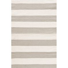 We love this simply-striped ivory and taupe rug from Dash & Albert. | from $27