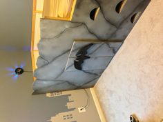 Bat cave for my trey man! We started with an ikea junior loft bed and ended with awesome!