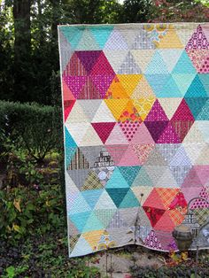 Unsettled quilt by StitchedInColor, via Flickr. One day, teal magenta and yellow will be like olive and harvest gold, but for now I still like it