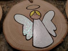 This listing is for one Angel ornament. Some angels have blonde hair, brown hair or are plain. Please specify at check out which angel you prefer. Approximate dimensions: 3 in diameter and 1/4-1/2 thick. These ornaments are made out of wood harvested from fallen limbs on our