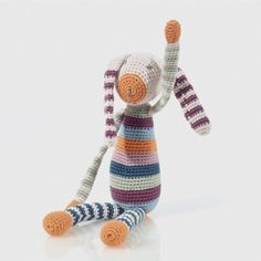 A handmade organic cotton crochet bunny with soft fill and a built-in rattle to stimulate your baby. Featuring long slender limbs which are perfect for the natural grasp reflex all babies are born with. Light weight and suitable from birth. Approx 30cm long. Material & Care – 100% organic cotton with 100% polyester fill. Warm wash on 40° or lower. Crochet Bunny, Hand Crochet, Hand Knitting, Funny Crochet, Cotton Crochet, Crochet Animals, Bunny Toys, Bunny Plush, Crochet Toys Patterns