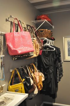 Curtain rod purse holder...instead maybe using a shower curtain tension rod and using decorative shower curtain rings...sounds easier than having to take off the whole rod to grab a certain purse like in this pic... :)