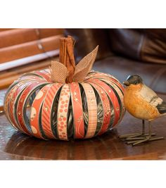 Home Decor doesn't need to be expensive.  Use your old canning rings, sprigs of cinnamon, and your favorite DCWV Fall stack to create this fabulous pumpkin decor! @joannstores #DCWV #Fall #Texture