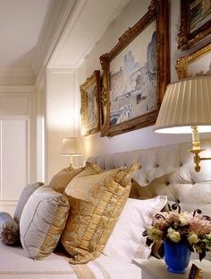 ornate frames above the bed give it such distinction. also love that they are not truly symetrical