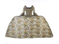 This magnificent gown originally belonged to Ann Fanshawe, daughter of Crisp Gascoyne who became Lord Mayor of the City of London in November 1753. This type of dress with its very wide skirt and short train was called a 'mantua'. Mantua gowns are first mentioned in England around the 1670s. The name might have been derived from the French word for coat, manteau, or from Mantua, the Italian town where expensive silks were produced. Production Date: 1751-1752