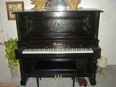 Antique upright piano. I have one from 1860. Lighter finish. More ornate.