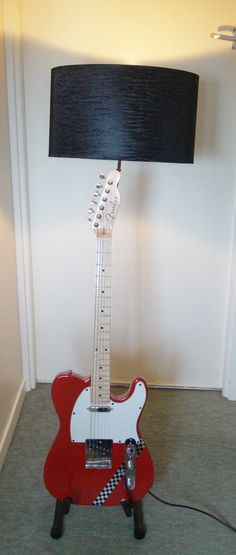 Up-cycled Fender guitar lamp. Animal print shade, on-off switch on body & guitar stand. Available for sale.