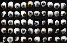 tray of example glass eyes on display at the medical shop of ocularist Gerhard Greiner who makes prosthetics, germany