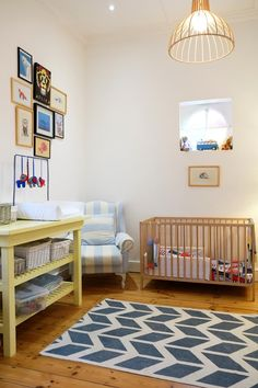 A mix of old and new creates such a fun and welcoming atmosphere in this nursery. A combination of various muted colors, bright light, and crisp white walls make this nursery the place to be!