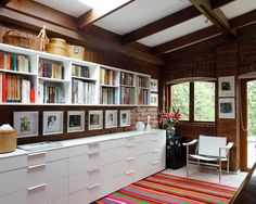 like the pictures between the drawers and the shelves - plus, they really stand out against the brick wall!