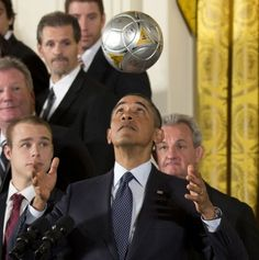 President Barack Obama bounces a soccer ball on his forehead during a ceremony in the White House honoring the Stanley Cup champions Los Angeles Kings and the Major League Soccer champion LA Galaxy for their 2012 championship seasons on March 27, 2013