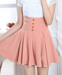 High wasted, salmon-pink skirt. The buttons make this :)