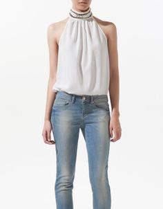 camisa de cuello sin mangas