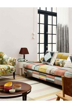 Living Room With A Neutral Decor Is Livened Up By Grid Sofa And Nature Patterned Armchair Interior Design Ideas Inspiration From HOUSE House