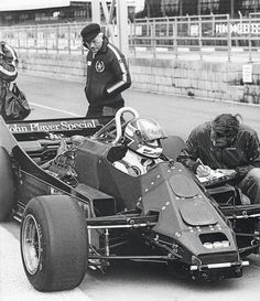 Nigel Mansell in the Lotus 88. Colin Chapman inspects the rear of the car.