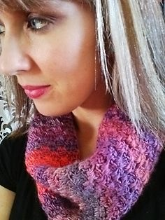 This cowl uses unforgettable yarn, drop stitches (where you work stitches into a previous row) to make a warm but still light and stretchy fabric that works perfectly with the self-striping property of Red Heart Boutique Unforgettable yarn. You can also substitute any worsted weight yarn you like. It would look great alternating solid colors for a bolder stripe effect!