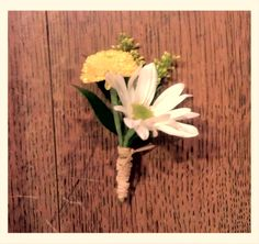 Yellow Button Mum, White Daisy Mum, Yellow Solidago, Stem Wrapped with Natural Raffia.  Created at Lexington Floral in Shoreview, MN. #countrywedding #rusticwedding #yellowwedding #yellowcorsage #yellowflowers #daisycorsage