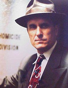 Tom Hagen (The Godfather). Love both Robert Duvall and his character Tom Hagen. Both intelligent men!!