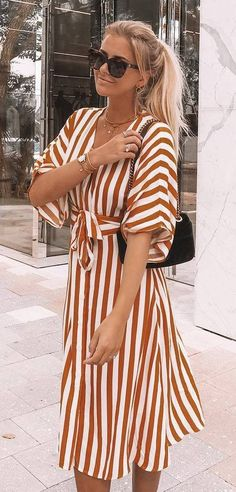 fashionable outfit_striped dress and velvet bag