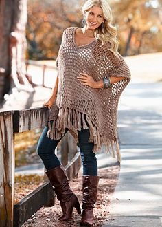 Crochet fringe poncho. Unfortunately this does not have an attached pattern or tutorial, but I would love to find a pattern look like this and make one of these for next fall/winter. This would be a beautiful crochet project!