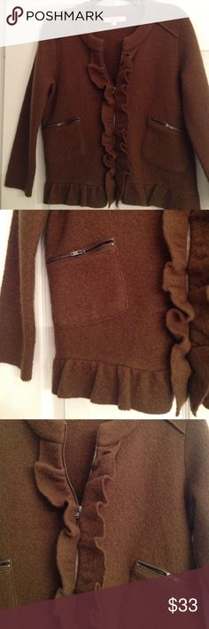 "100% PURE MERINO WOOL ZIPPER FRONT JACKET Such a great colour! My camera doesn't show the beauty of this nutmeg shade.. Brown with a hint of green! Pure Merino Wool..Ruffles front and center and all around the hemline! Zip up front and zippers on front pockets..Length: 22.5"".. In excellent condition! LOFT Jackets & Coats"
