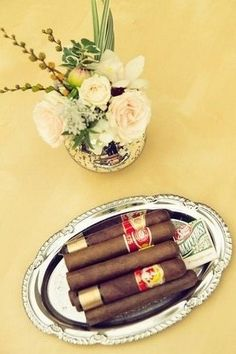 1950s Wedding Ideas | Confetti Daydreams - Cigars displayed upon a silver platter ♥ #1950s #wedding #inspiration #ideas
