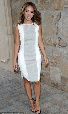 All white:Wearing a white Karigam dress that would set you back $725, Melissa Gorga looked fresh and pretty