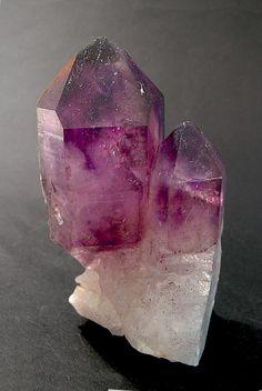 Looks like a mix between amethyst  and quartz