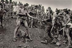 Dispute between Serra Pelada gold mine worker and military police, Brazil 1986. © Sebastião Salgado.