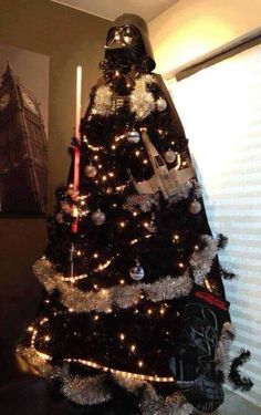 Deck out your tree like you're part of the dark side by spray painting a fake tree black.