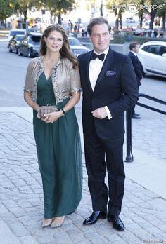 La princesse Madeleine de Suède enceinte, et son mari Chris O'Neill lors du concert de la diète royale (le parlement suédois) dans le cadre du jubilé des 40 ans de règne du roi Carl XVI Gustaf à Stockholm le 14 septembre 2013