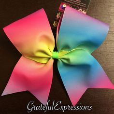 Ombré Neon Cheer Bow by GratefulExpressions on Etsy https://www.etsy.com/listing/243367967/ombre-neon-cheer-bow