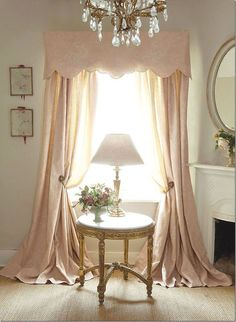blush drapes flooding the floor with a sleek valence
