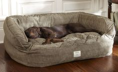 Orvis Dog Bed $169.00  Wrapped in a velvety-soft microfiber with piping along the bolster edges, and stuffed with fluffy spun-polyester fill. Bolster and sleeping pad covers are removable and washable.